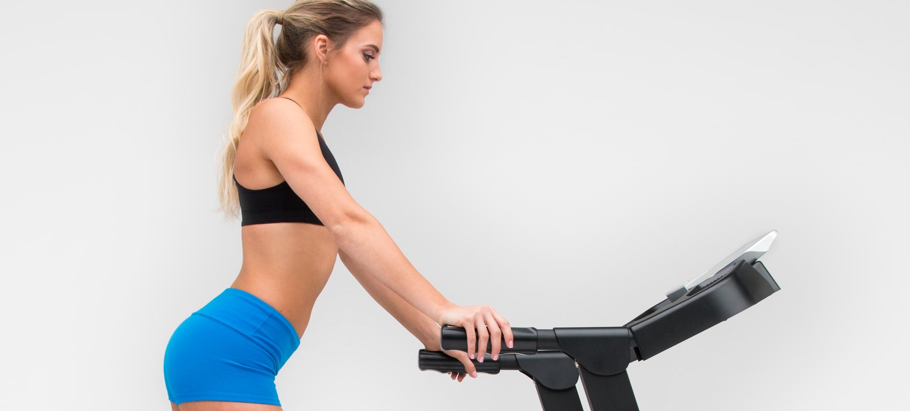 Is it OK to hold the front handlebars while exercising on my treadmill